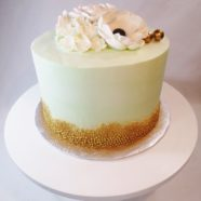 gold and mint green cake