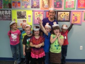 """Check out these kinders with their """"OLIVE TO READ"""" crowns!"""
