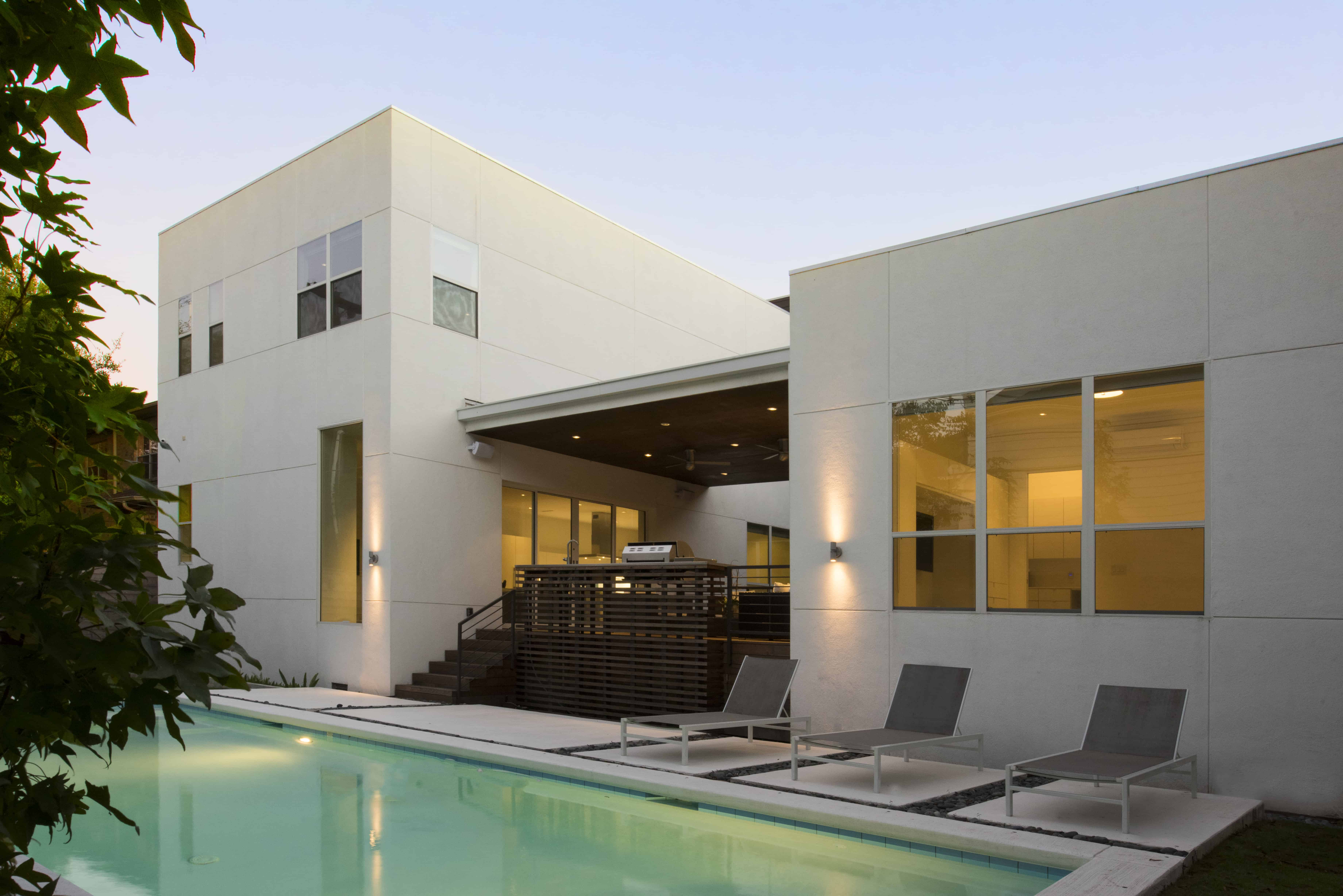 modern home raised to prevent flooding backyard with pool