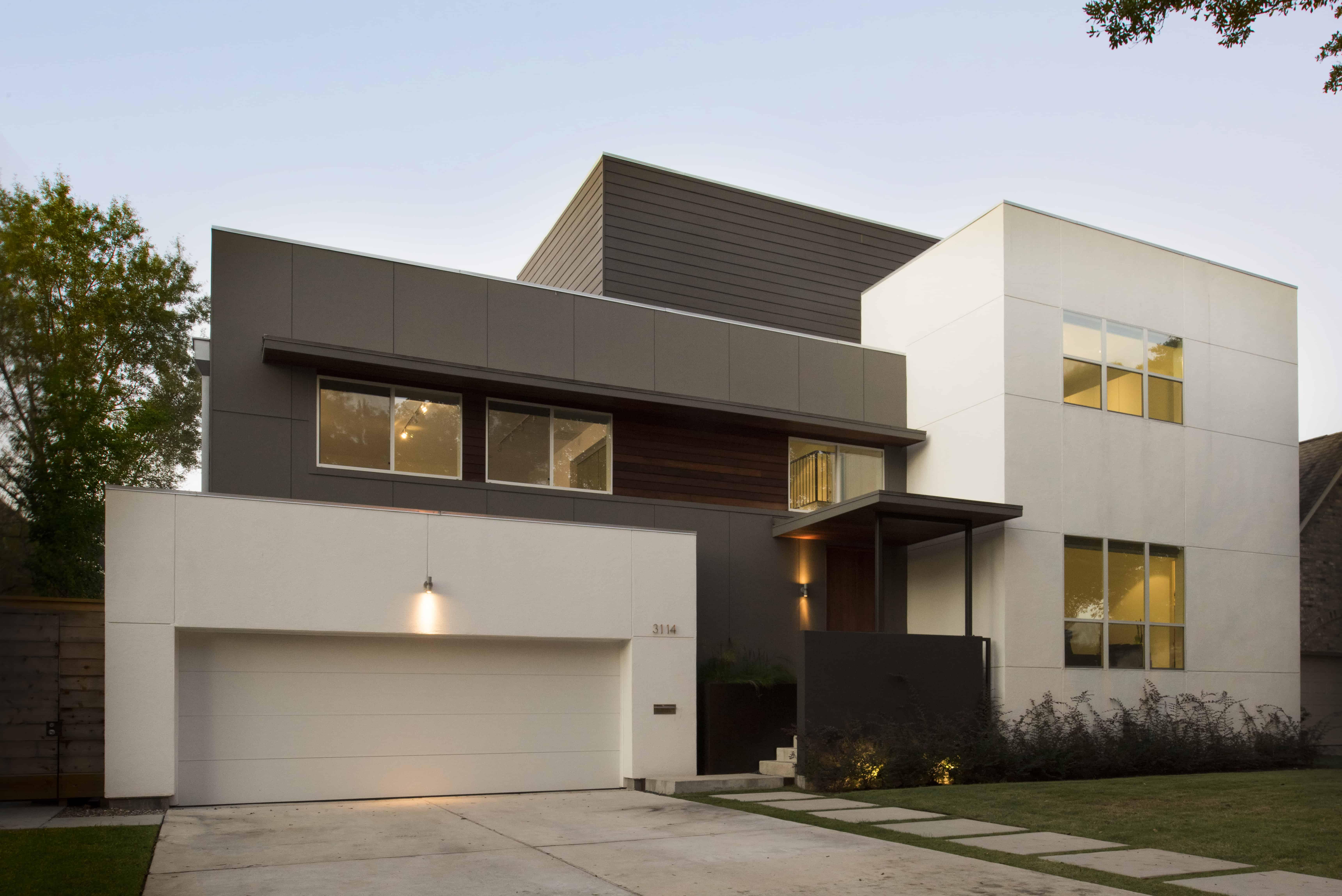 modern home raised to prevent flooding braeswood houston