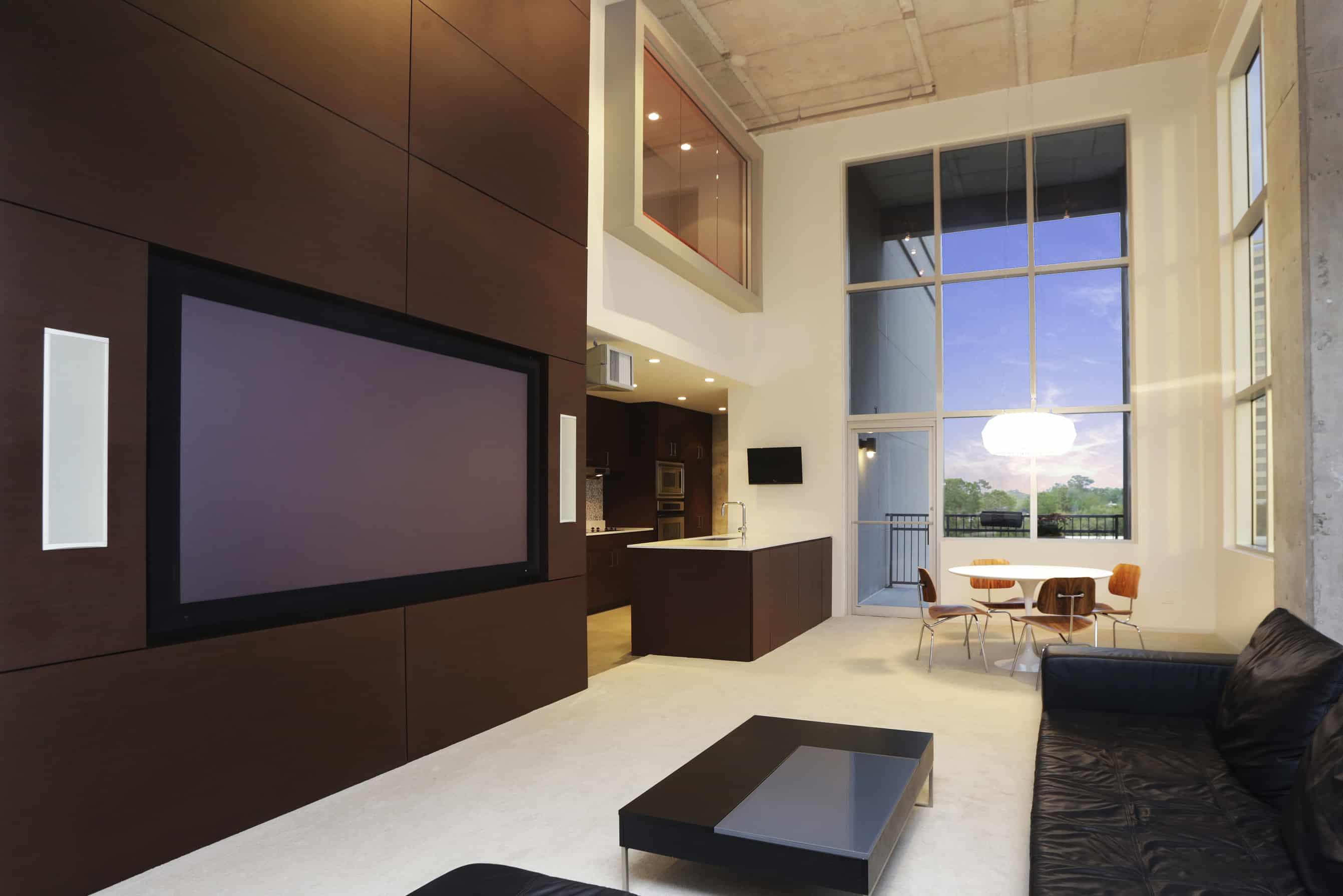 Memorial Luxury Loft bedroom industrial mid century furnishings walnut wood kitchen with high ceiling