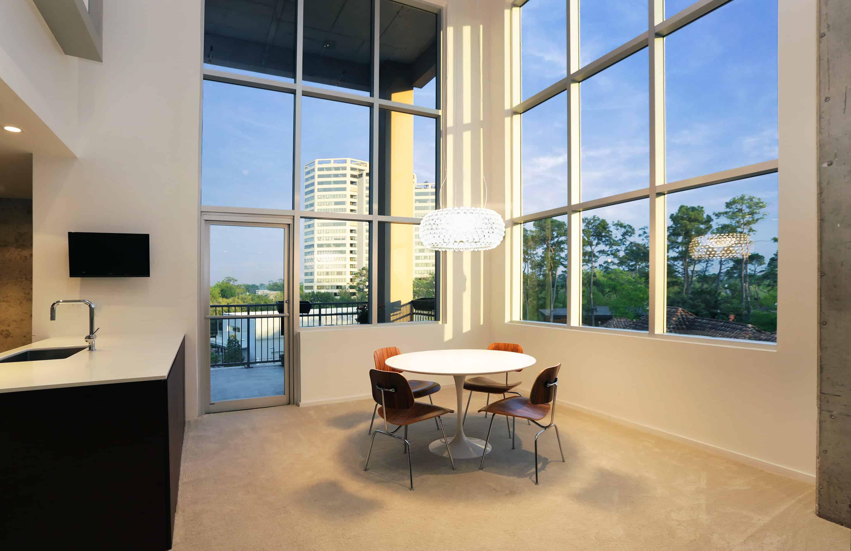 Memorial Luxury Loft bedroom industrial mid century furnishings walnut wood kitchen with large glass