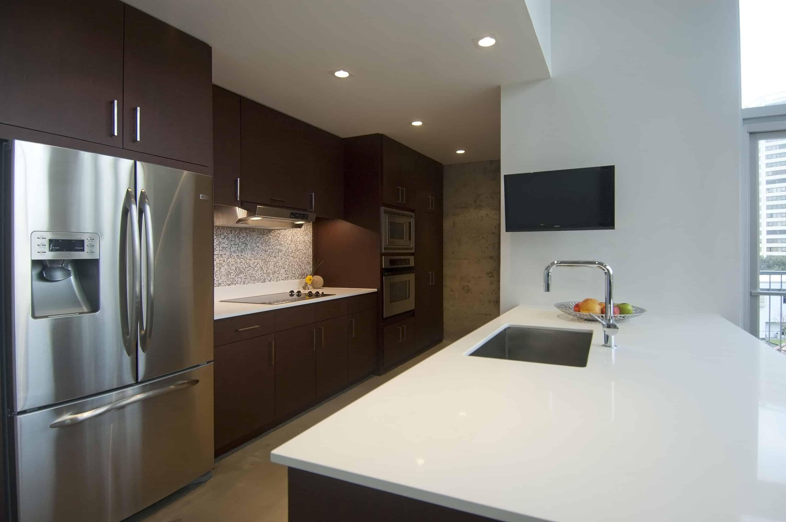 Memorial Luxury Loft bedroom industrial mid century furnishings walnut wood kitchen
