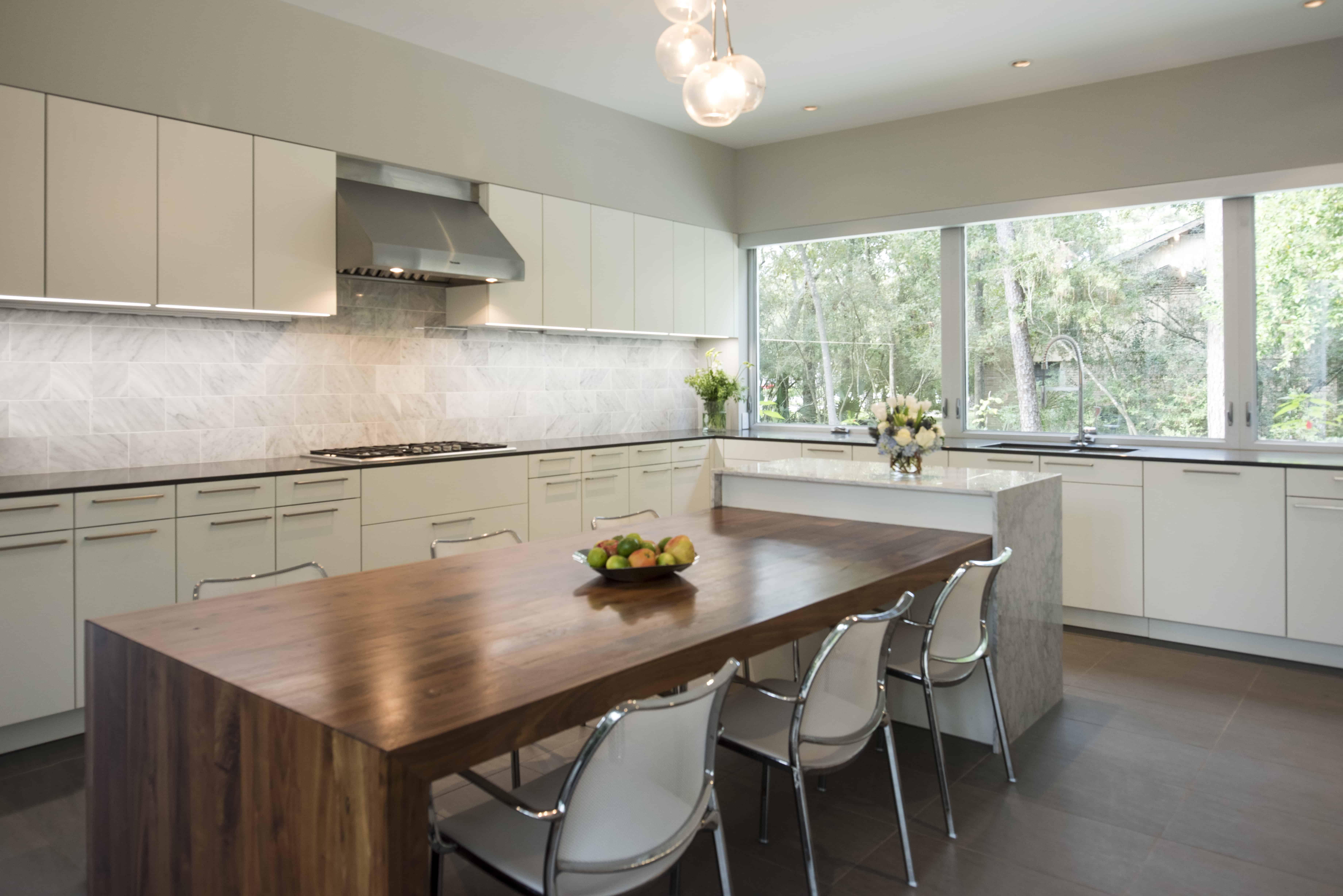 Hunters Creek Memorial Modern Custom Home kitchen grey and white with walnut island