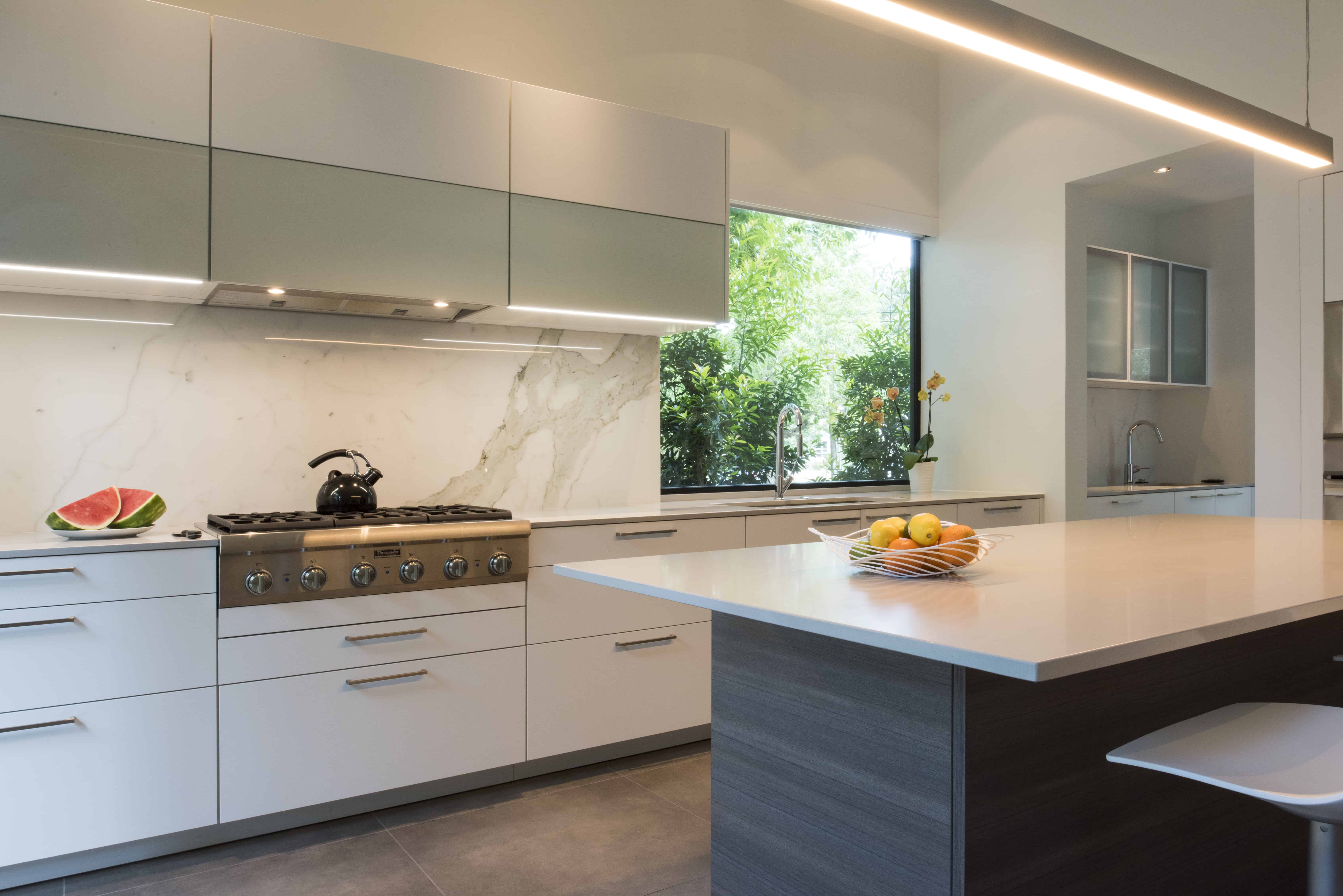 Empty Nester Modern Home with Lock and Leave and Aging in Place Features Kitchen white and grey.