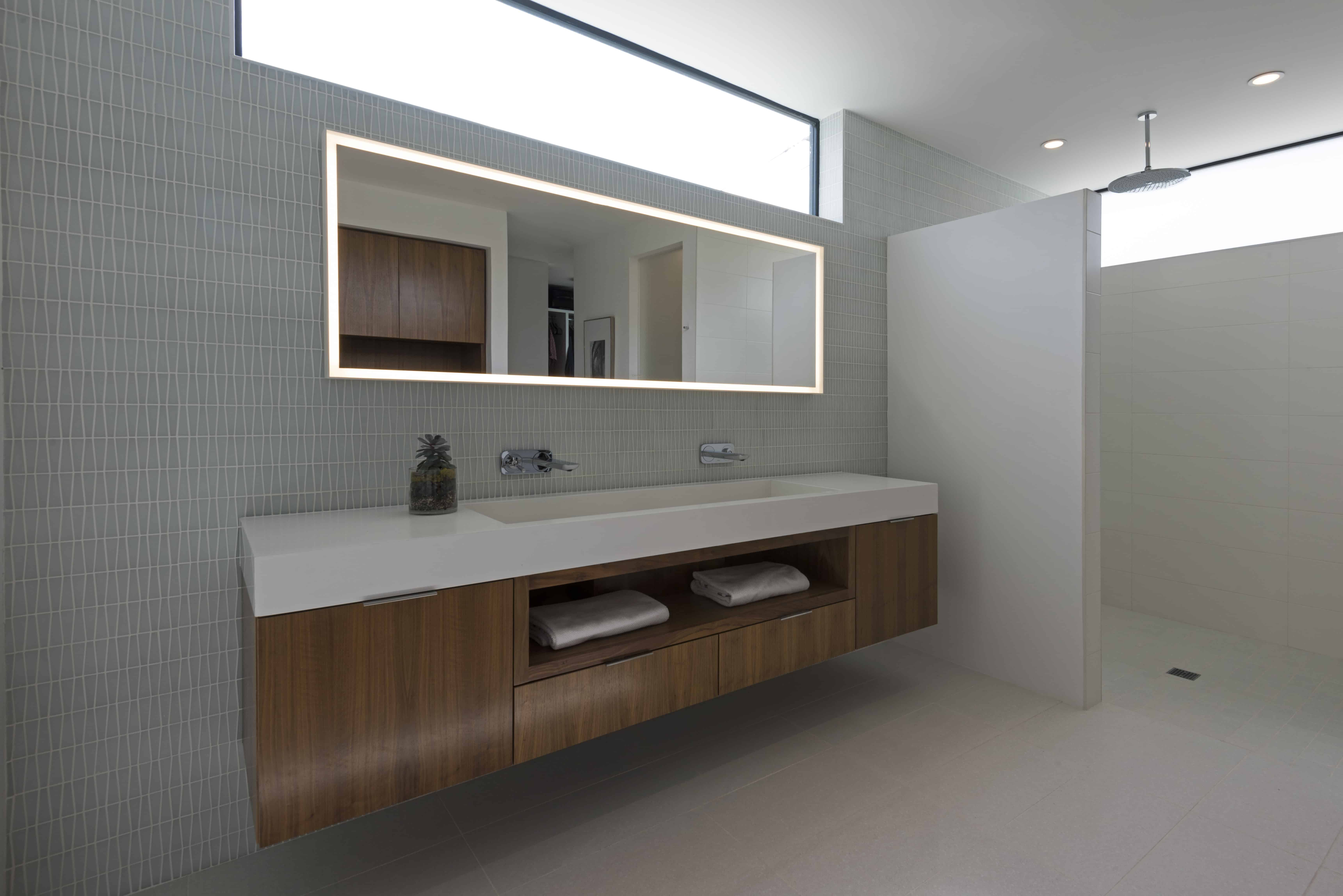 mid century modern inspired warm toned master bath