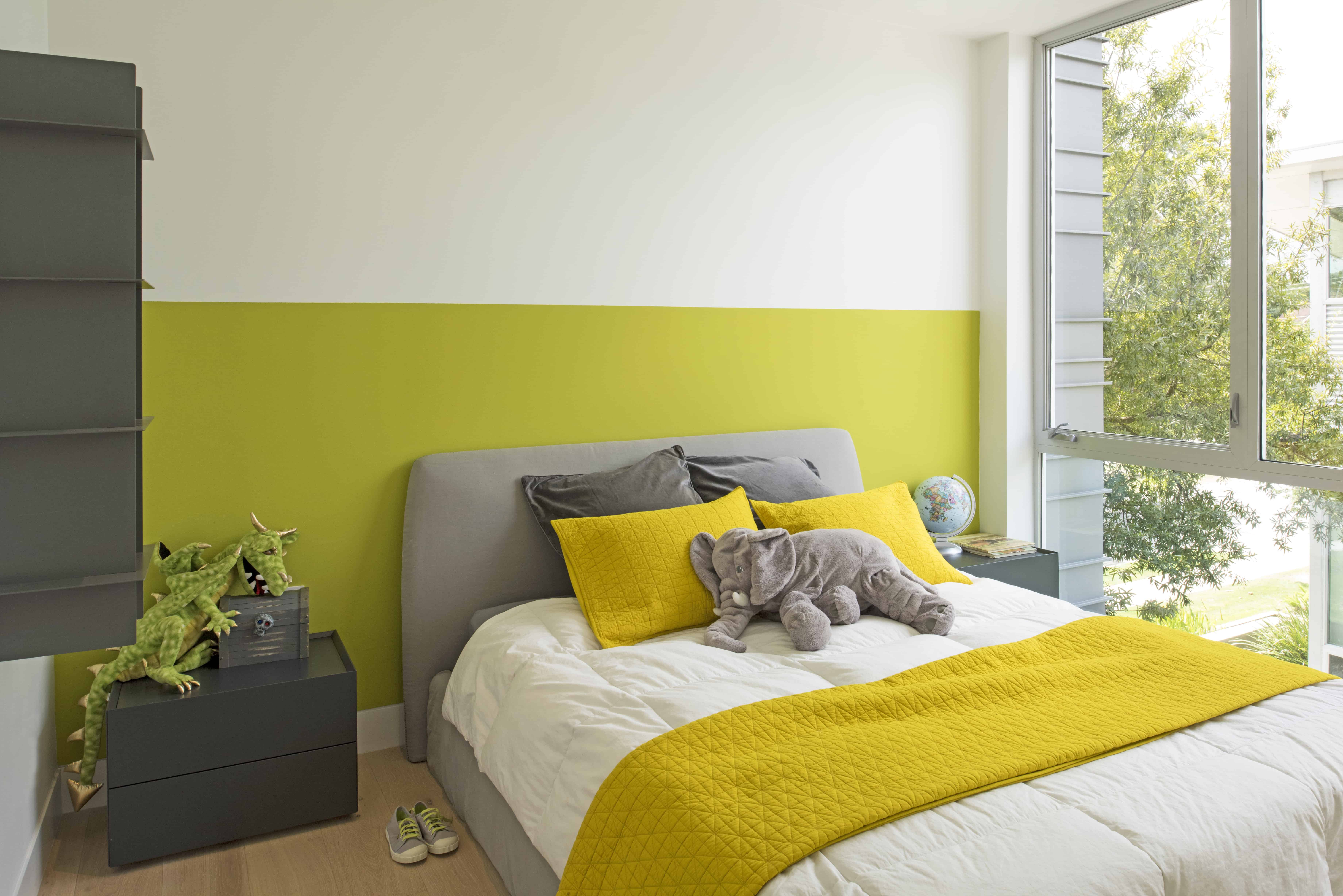 modern green and yellow kids bedroom with large window