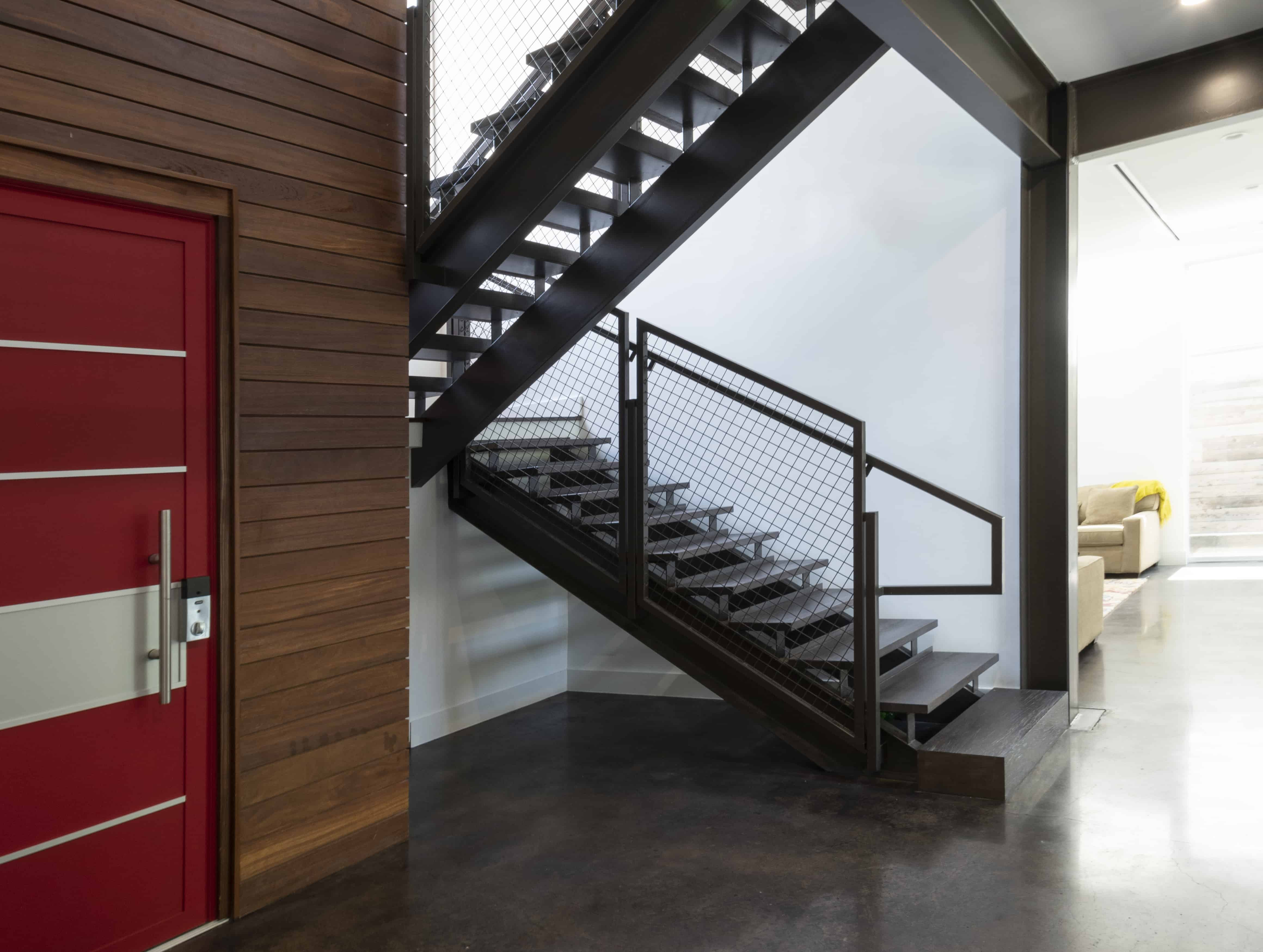 university boulevard modern home family lifestyle open stair and red front door