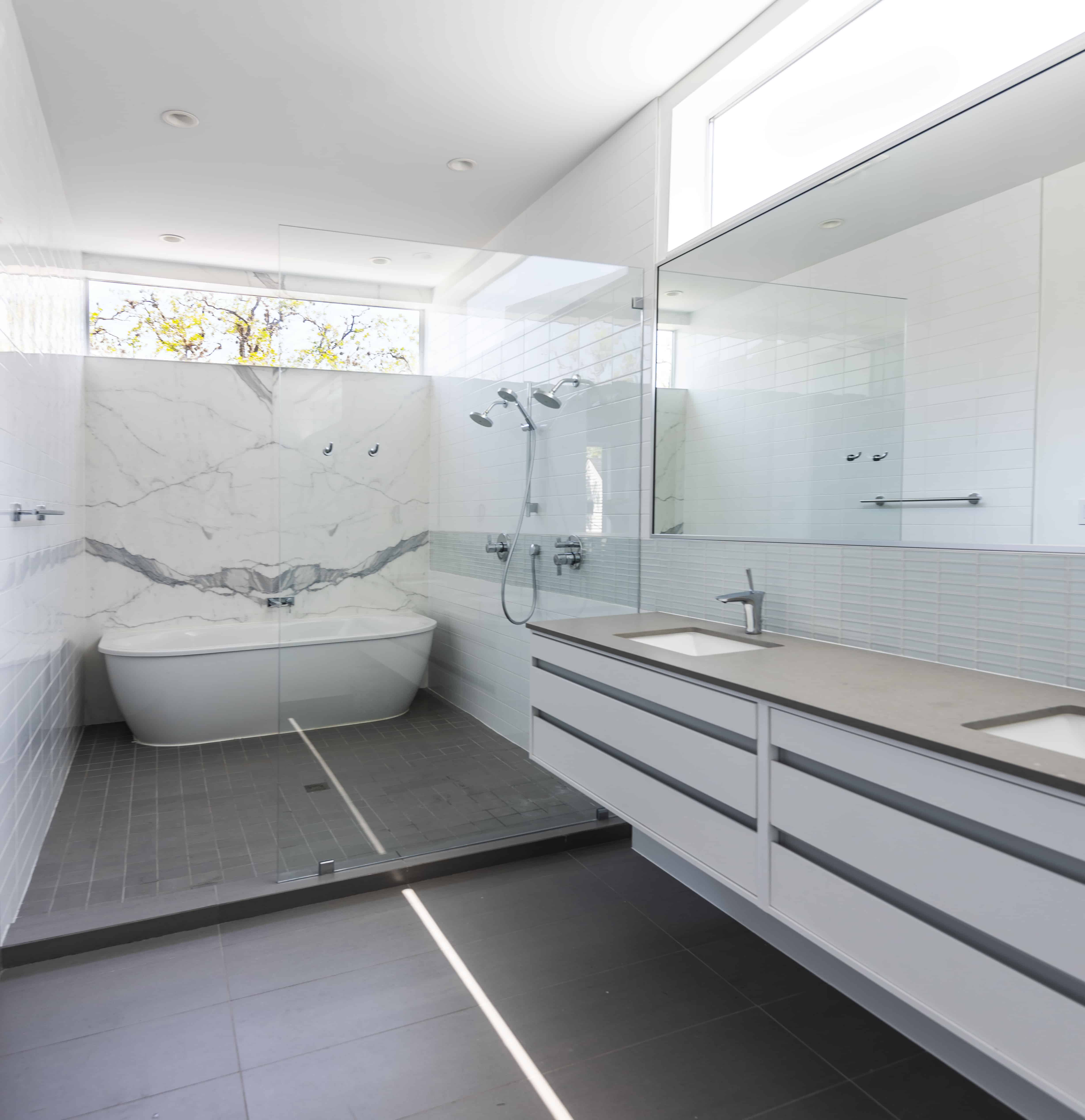 university boulevard modern home family lifestyle master bath with marble grey and white finishes