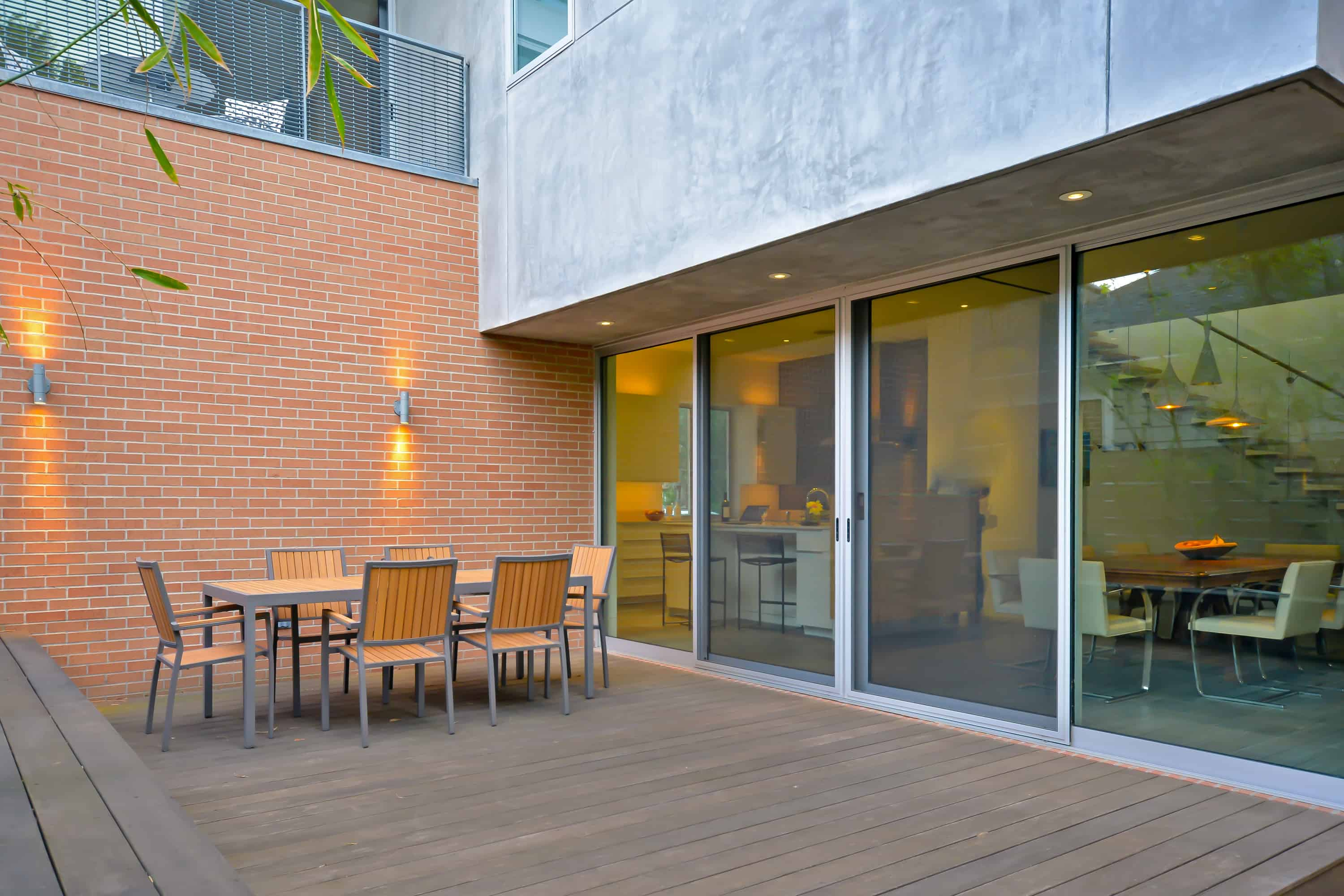 West University Brick Wall and Deck with outdoor dining