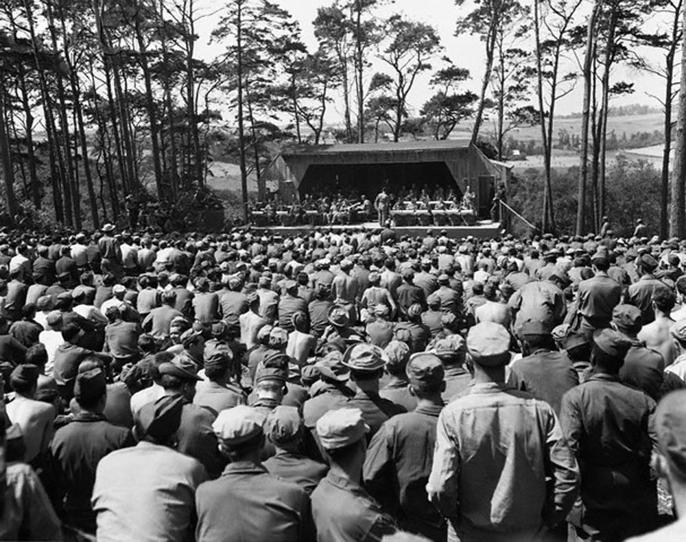 28 Jul 1945, Le Havre, France --- US soldiers listen to a Saturday afternoon jam session by Glenn Miller's Band at Camp Herbert Tareyton near Le Havre, France. --- Image by © CORBIS