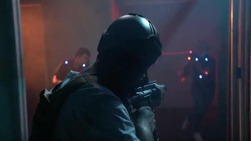 man in helmet playing laser tag