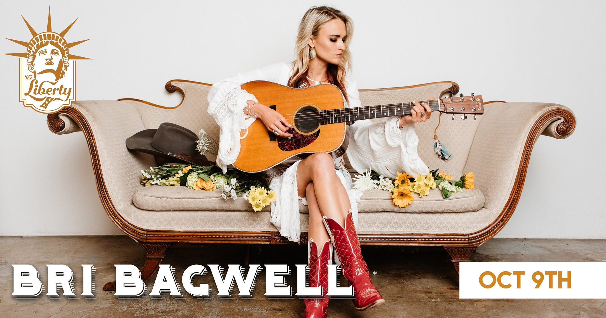 bri bagwell its on couch holding guitar