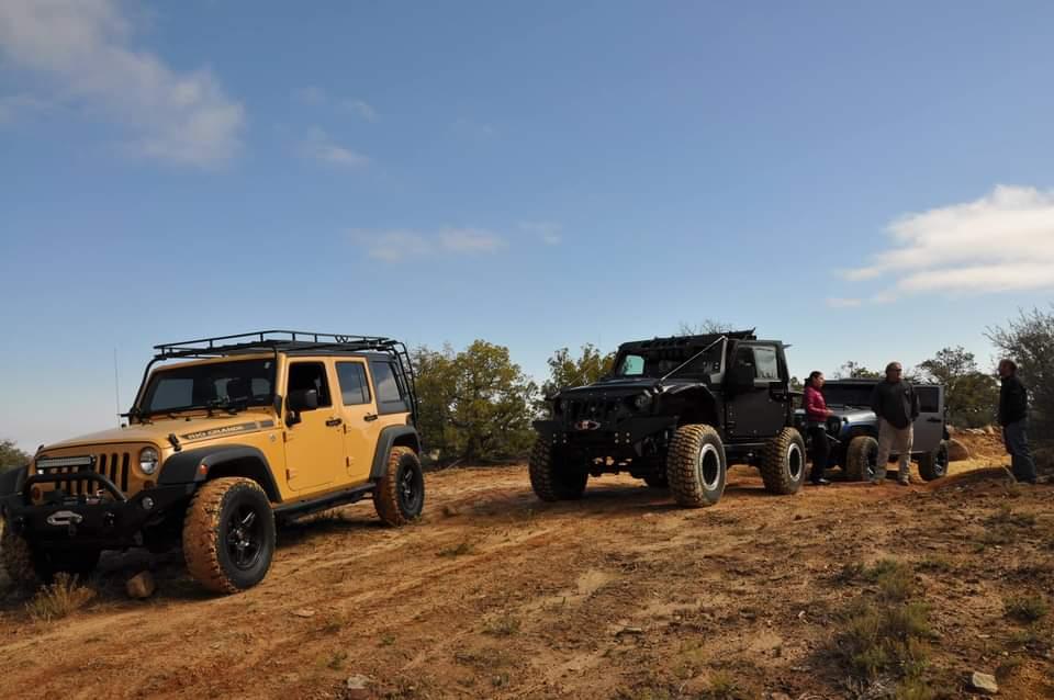 2 jeeps in open field