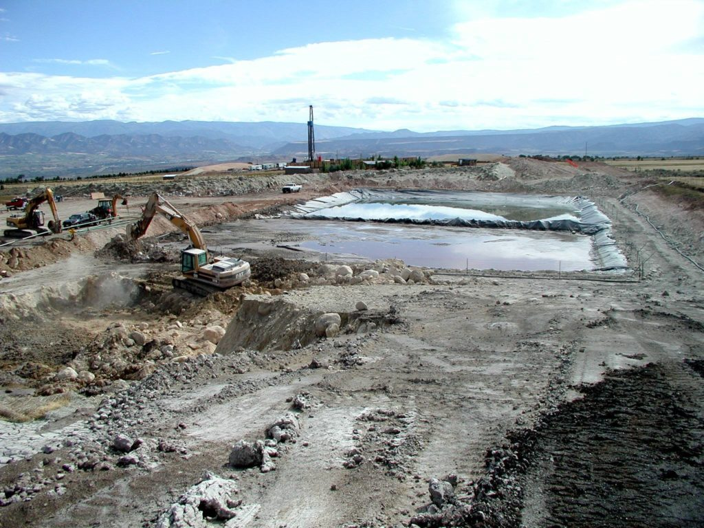 Well pad, evaporation pond and heavy equipment south of Silt, Colorado