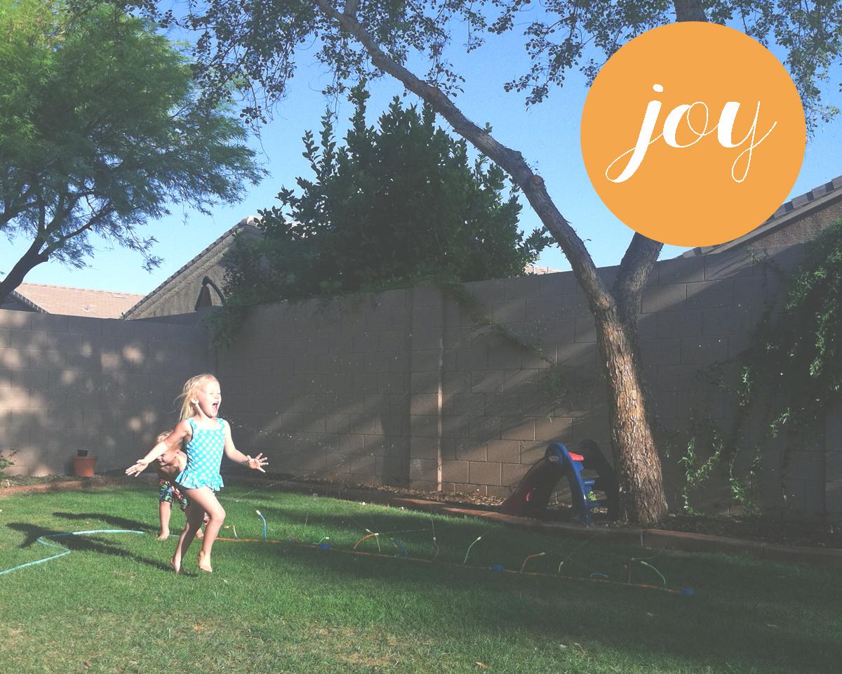 Joy is...running through sprinklers