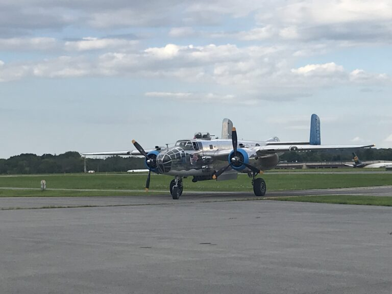 Old Glory Vintage Warplane front propeller runway