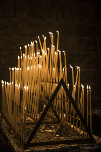 White prayer tapers at the Chartres Cathedral by photographer Jill K H Geoffrion