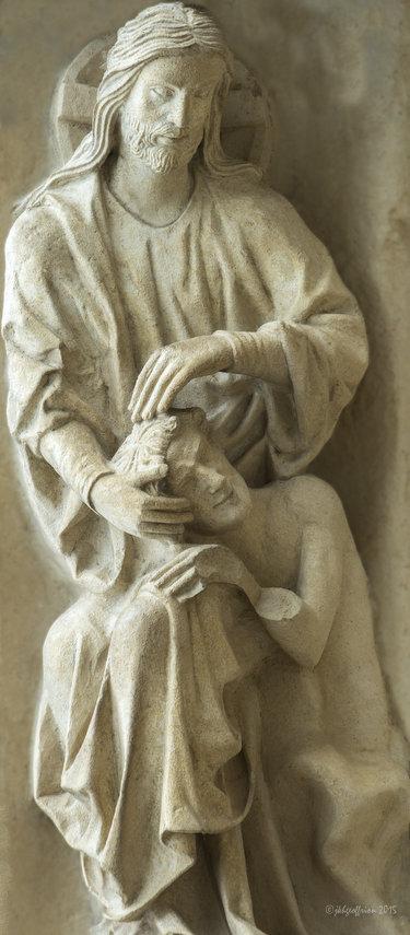 God creating humanity, thirteenth century sculpture