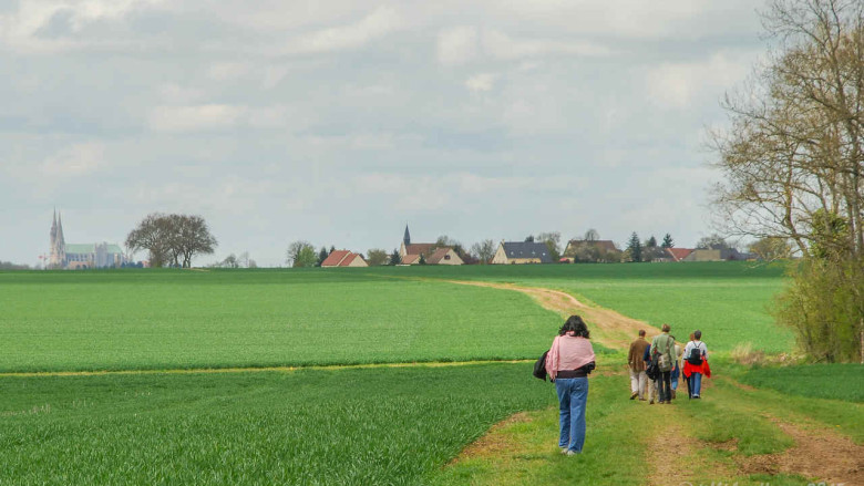 Pilgrims Walking To Chartres by photographer Jill K H Geoffrion