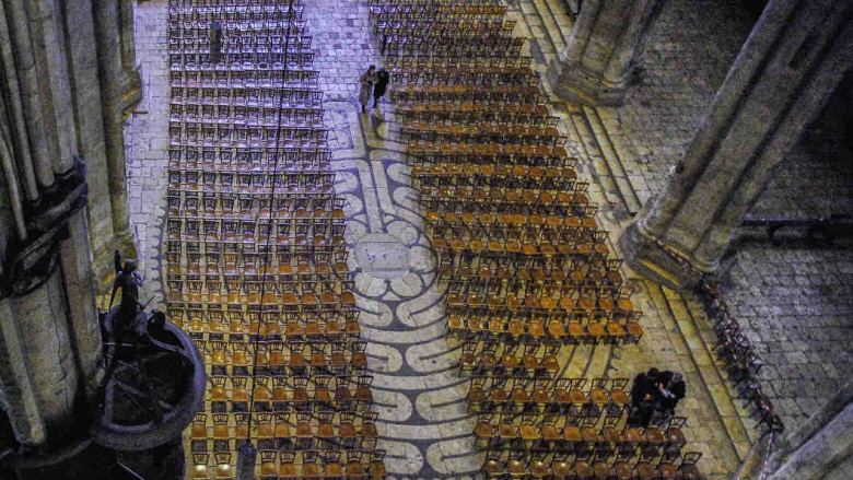 The labyrinth in the nave covered by chairs