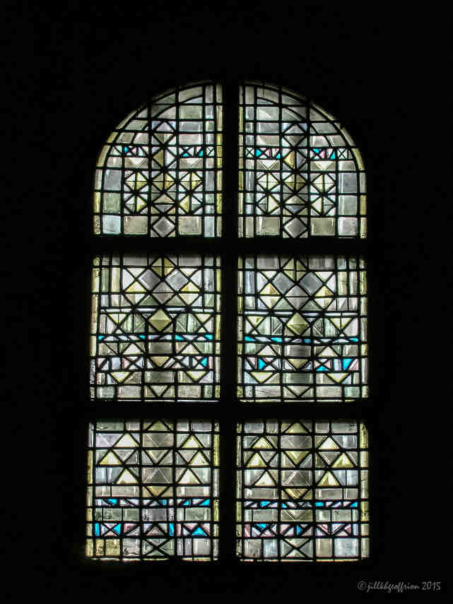 Modern stained glass window in the south ambulatory of the crypt of Chartres Cathedral by photographer Jill K H Geoffrion