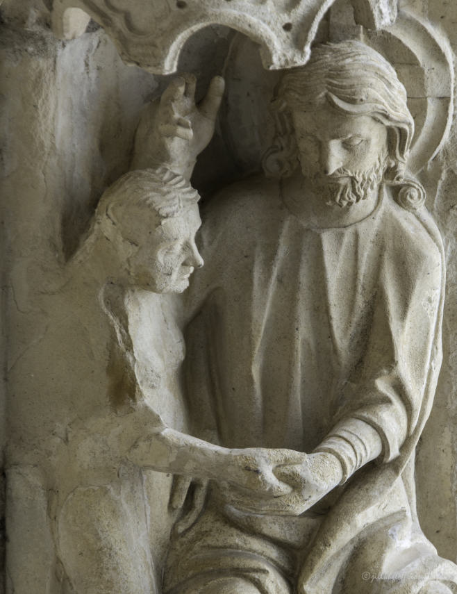 God creating Eve at Chartres Cathedral by photographer Jill K H Geoffrion