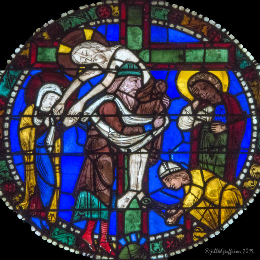 Jesus' body being taken off the cross in the Passion and Resurrection Window by Jill K H Geoffrion