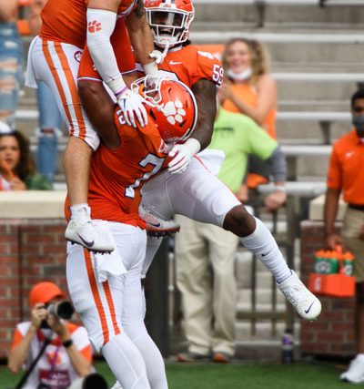Clemson linebacker James Skalski(47) celebrates with his teammates after picking up a forced fumble and scoring a touchdown during the first quarter of their game against The Citadel Saturday, Sept. 19, 2020.