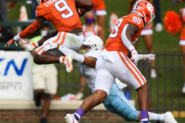The Citadel defensive back Chris Beverly(17) tries to tackled a leaping Clemson running back Travis Etienne(9) during the first quarter of their game against The Citadel Saturday, Sept. 19, 2020.