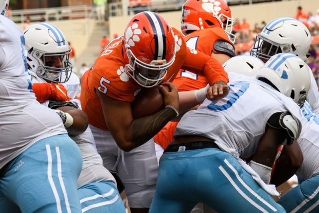Clemson quarterback D.J. Uiagalelei (5) pushes past The Citadel defense to score a touchdown during the second quarter of their game Saturday, Sept. 19, 2020.