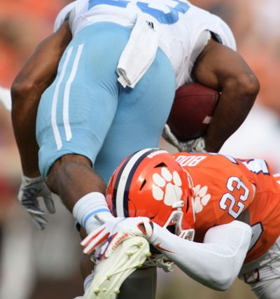Clemson corner back Andrew Booth Jr. (23) tackles The Citadel sophomore Keefe White (23) during the second quarter of their game Saturday, Sept. 19, 2020.