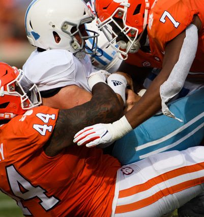 Clemson defensive tackle Nyles Pinckney (44) and Clemson defensive end Justin Mascoll (7) sack The Citadel quarterback Brandon Rainey (16) during the second quarter of their game Saturday, Sept. 19, 2020.