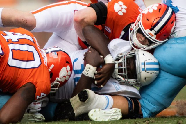 Clemson linebacker Jake Venables (15) and defensive end Greg Williams (40) take down The Citadel sophomore Emeka Nwanze (32) during the second quarter of their game Saturday, Sept. 19, 2020.