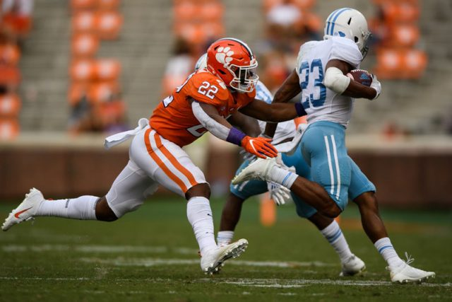 Clemson linebacker Trenton Simpson (22) attempts to taken down The Citadel sophomore Keefe White (23) during the third quarter of their game Saturday, Sept. 19, 2020.