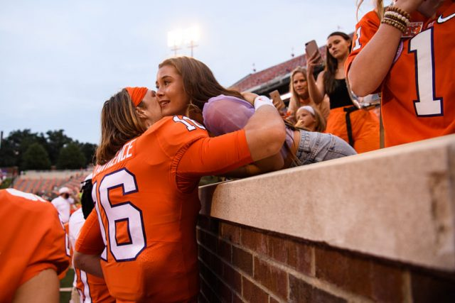 Clemson quarterback Trevor Lawrence(16) embraces his fiancŽ Marissa Mowry after their game against The Citadel Saturday, Sept. 19, 2020.