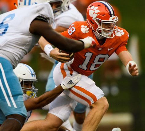 Clemson quarterback Hunter Helms(18) attempts to evade The Citadel defense as he runs the ball during the fourth quarter of their game Saturday, Sept. 19, 2020.