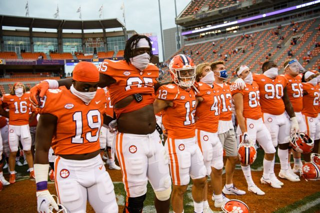 Clemson players sing their alma mater after their game against The Citadel Saturday, Sept. 19, 2020.