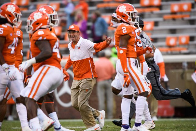 Clemson head coach Dabo Swinney celebrates with his team as they run on the field after their game against The Citadel Saturday, Sept. 19, 2020.
