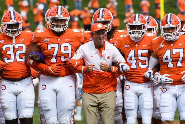 Clemson head coach Dabo Swinney walks with his players during the walk of champions before their game against The Citadel Saturday, Sept. 19, 2020.