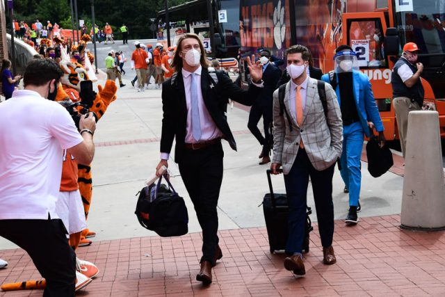 Clemson quarterback Trevor Lawrence(16) and other players arrive at Memorial Stadium before their game against The Citadel Saturday, Sept. 19, 2020.