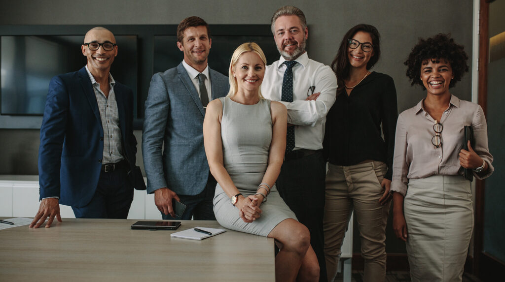 Diverse business professionals together in meeting room