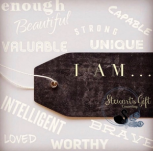 "Label with text ""I AM..."" surrounded by positive attributes, Enough, Beautiful, Brave...etc"