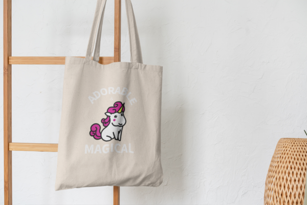 Adorable and Magical Tote Bag hanging on wooden decor