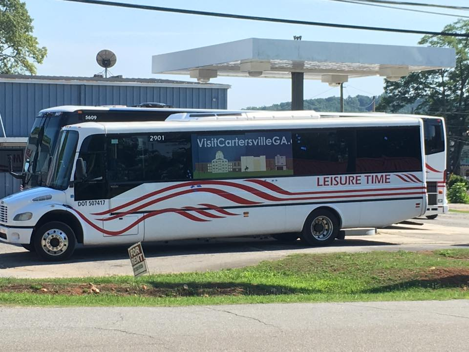 2901 Bus with Visit Cartersville GA sign parked at Leisure Time offices.