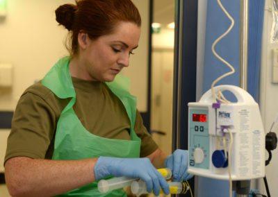 Army Nurse Operating Medical Equipment at Camp Bastion Hospital, Afghanistan