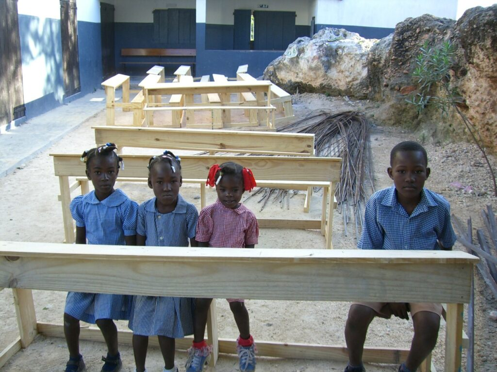 Young students trying out the new desks.