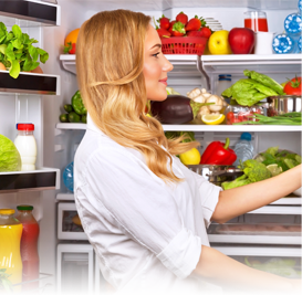 Woman standing at refrigerator