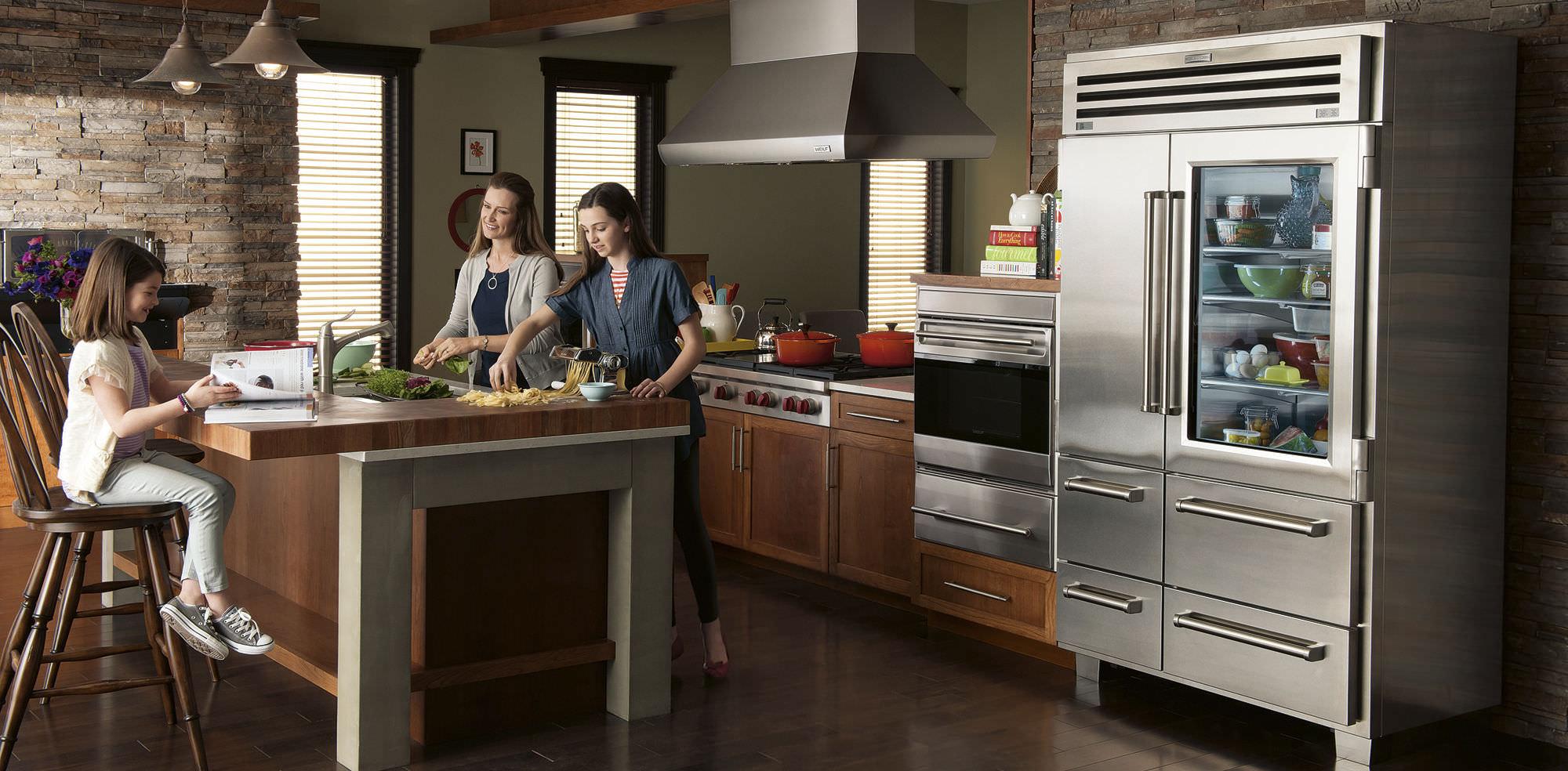 family preparing a mean in their kitchen full of sub-zero appliances
