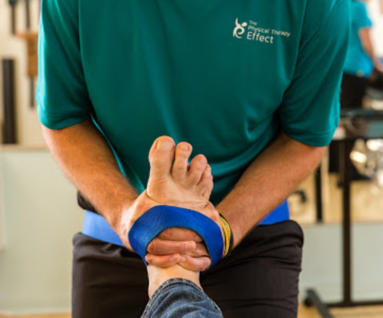 Doctor of physical therapy working on patient's foot